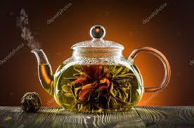 <b>чайник</b> стеклянный с цветущих чай цветок на деревянный стол ...