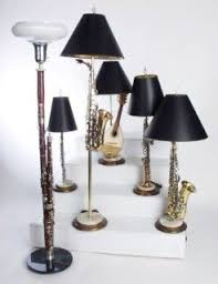 Turn old musical instruments into lamps...I'd choose different lamp shades