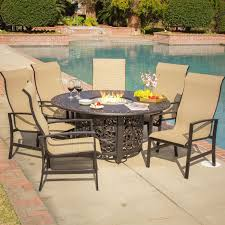 outdoor patio set with fire pit including round dining table and