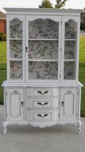 White painted china hutch with wallpaper backing. by sandhara Use different  wallpaper.