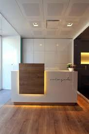 front office designs. love this flooring option again we need underlighting cool glossy white front desk warm but clean office designs n