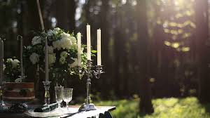 dinner table background. Close Up Of White Vintage Candelabrum On The Wedding Decorated Table In Forest. Bouquet Dinner Background