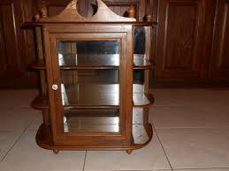 image of glass door curio cabinet