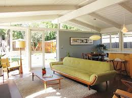 View in gallery Cool interior borrows heavily from a Mid-Century style
