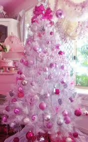 What a better way of turning a white tree into something pinkish other than  adding pink ornaments and decorations on them?