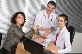 What Is A Pharmaceutical Sales Rep Woman Pharmaceutical Sales Representative With Two Doctors Stock