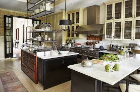 With An Impeccably Designed Kitchenu2014reclaimed Hardwood, Black Lacquered  Cabinets, Carrara Marble Counters