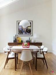 a retro modern dining room that belongs to chelsea cefai it is a scandinavian design clic in lighting and looks really cool in this modern dining room