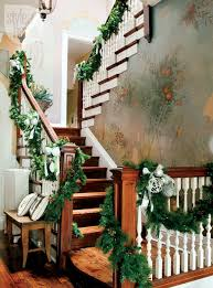 Loosely swagged pine ropings could be used on any staircase. Don't forget to