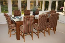 teak dining tables uk. shown here as a dining table teak tables uk