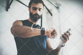 Results By Design Fitness Photo Bearded Sportive Man After Workout Session Checks