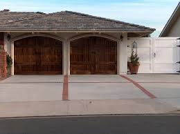 swing out garage doorsArched garage doors that look like barn doors that swing out in
