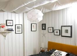 Unfinished basement laundry room ideas Curtains If The Rafter Ceiling In Your Unfinished Basement Feels Too Cold And Industrial For Your Taste Soften It By Hanging Swaths Of Fabric To Create Beautiful Bob Vila Unfinished Basement Ideas Affordable Tips Bob Vila