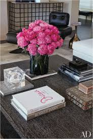 fake chanel books for decor hot pink fl arrangement takes center stage on this coffee table