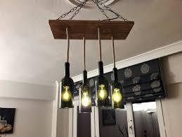 liquor bottle chandelier liquor bottle chandelier diy cam aiae avize glass bottle chandelier s instagram