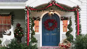 Traditionally decorated front porch with reds and greenery