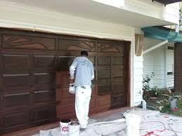 can you paint a metal garage door plain steel builder grade garage doors stained to look