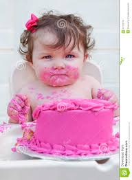 Closeup Of A Baby Girl Eating Her 1st Birthday C Stock Photo Image