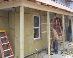 Wrapping An Older House With Rock Wool Insulation - Insulating block walls exterior
