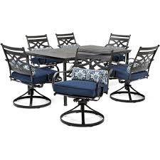 hanover montclair 7 piece steel outdoor dining set with navy blue cushions swivel rockers and