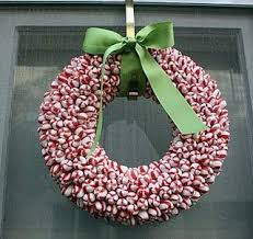 Peppermint Wreath * these are really simple to do ~ all you need is a glue  gun, a foam wreath, and peppermints. The peppermint wreath is with a flat  back.