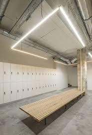 gym lighting design. das studio converts parisian factory into indoor cycling gym lighting design