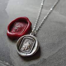 sun wax seal necklace with latin motto