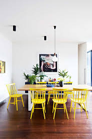 yellow upholstered dining chair part  ways to lift any space with yellow styling by heather nette king phot