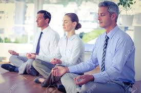how to meditate in office. Business People Doing Yoga On Floor In Office Stock Photo How To Meditate