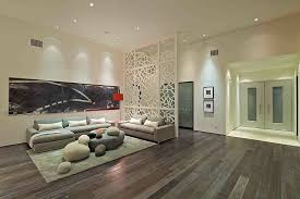 pattern of the room divider brings a hint of terranean charm to the contemporary living e