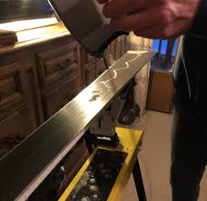 get your iron plugged in and warmed up usually the box of wax will tell you what rature to have the iron on then press the block of wax onto the