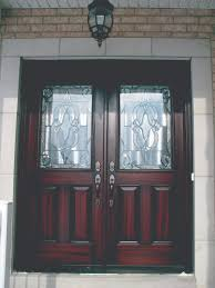 white double front door. Exterior. Carving Double Glass Front Doors With Brown Polished Wooden Frame Handle Connected By White Door .