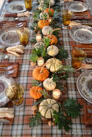 Thanksgiving table with assorted turkey plates, plaid tablecloth and easy  centerpiece with pumpkins, oak