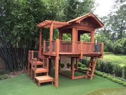 redwood playhouse with wire railings trapdoor platform steps and picnic table