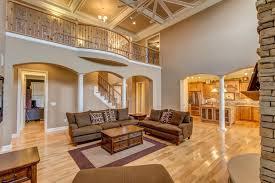 traditional living room ideas. Traditional Living Room With High Ceiling, Box Stone Fireplace, Hardwood Floors, Ideas P