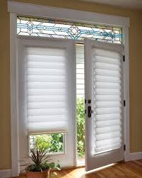 white roman shade on french door with stained glass