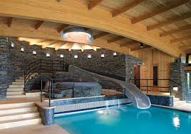 mansion with indoor pool with slides. Interesting With Wood Stone And Glass Make For A Space As Beautiful It Is Dramatic  Architecture By Joseph Cincotta LineSync Architecture And Mansion With Indoor Pool Slides I