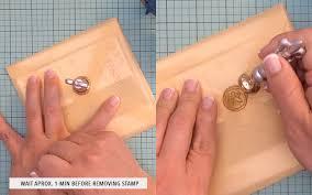 diy metallic gold wax seal on wedding invitation print