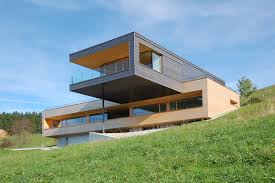 A Cantilevered Home Overlooking a Lake in Austria ...