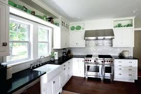 white kitchen cabinets with black countertops white kitchen cabinets