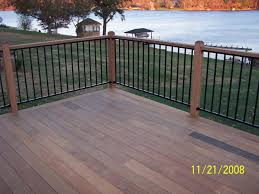 wood deck cost. Charming Brown Wooden Deck In Cheap Trex Decking Cost Matched With Black Railing For Patio Decor Ideas Wood T