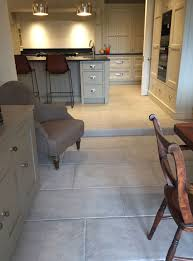 Limestone Flooring In Kitchen Antiqued Grey Stone Tiles Have Been Used To Create This Grey Stone