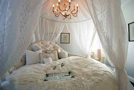 This is one of the most romantic examples we could find. Big fluffy pillows  and comforters with full netting canopy.