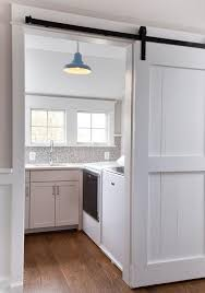 blue vintage barn pendant in white cottage laundry room