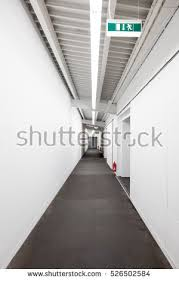 hallway vanishing point. long white technical corridorescape corridoremergency exit with fire extinguishertechnical corridor hallway vanishing point a