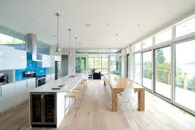 Example of a minimalist galley open concept kitchen design in Other with  blue backsplash and glass