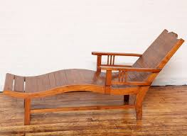 a 1940s dutch colonial style teak lounge chair from java with wavy seat and slanted back