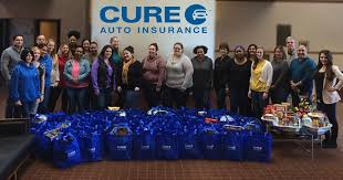 cure auto insurance employees came together to donate 65 thanksgiving day baskets to the arc of