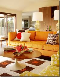 Retro inspired living room with orange sofa by designer Palmer