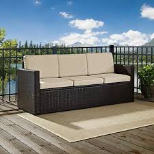 crosley furniture palm harbor outdoor wicker sofa in brown with sand cushions